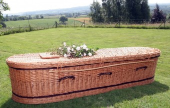 photo of oval shaped wicker coffin in Manchester