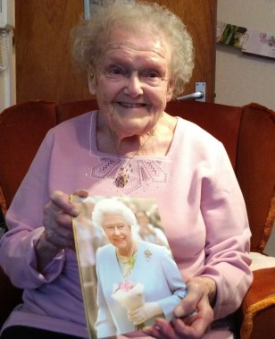 photo of Lily with her 100th Birthday telegram from HM Queen